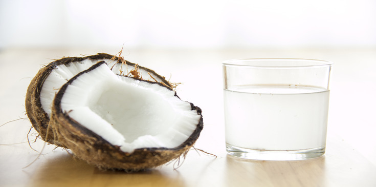 A glass of water from mature coconut