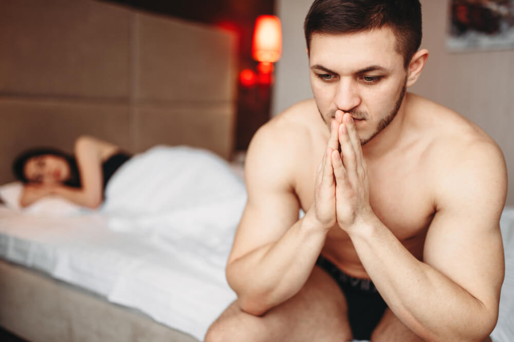 men disturbed on bed because of messy pbulic hair