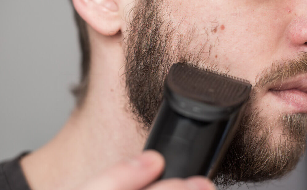 a man trimming with philips trimmer